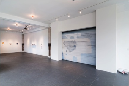 Installation View of Counterfeit Universe (artificial garage)