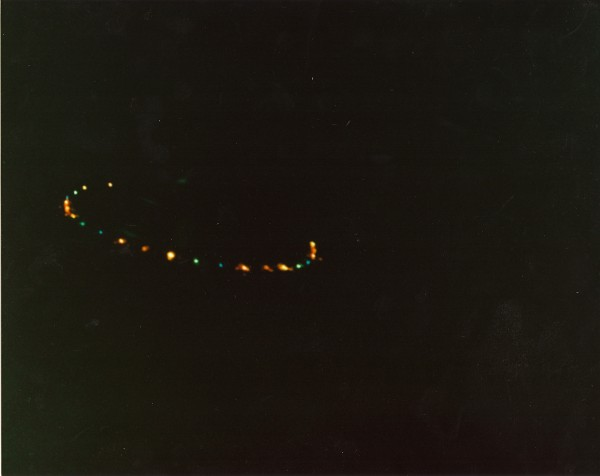 "Lights from an unidentified craft photographed by a state police officer over Route I-84 near Waterbury, Connecticut, in 1987. Thousands of people witnessed UFOs in the ""Hudson Valley wave"" of the mid 1980's. credit: Collection of Phil Imbrogno"